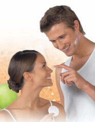 A man and a woman enjoying skincare.